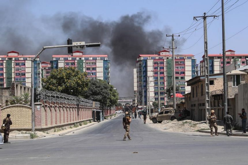 Afghan security officials secure the scene of a suicide bomb blast near a governmental institution in downtown Kabul, Afghanistan, on July 1, 2019.