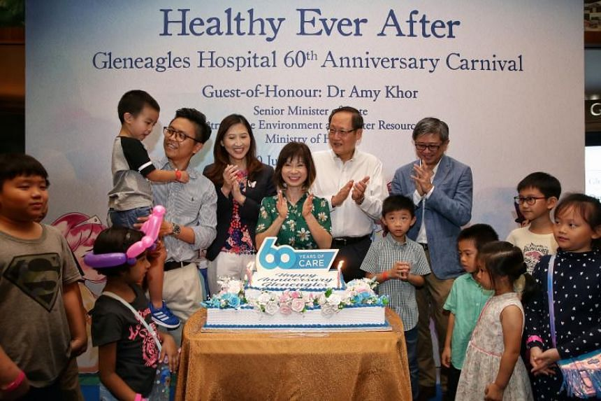 Senior Minister of State, Ministry of the Environment and Water Resources and Ministry of Health Dr Amy Khor (centre), with senior management from Gleneagles Hospital and Parkway Pantai, and beneficiaries of The Straits Times School Pocket Money Fund