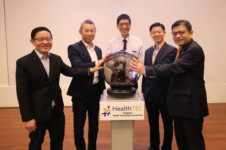 (From left) Director of HealthTEC and  iHealthtech, Professor Lim Chwee Teck; NUS deputy president of research and technology, Professor Chen Tsuhan; executive director of the Ministry of Health's Office for Healthcare Transformation and chief health