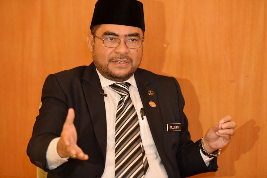 """Malaysia's de facto Islamic Affairs minister Mujahid Yusof Rawa was also attacked for saying reports of Muslim oppression in China were """"false news""""."""