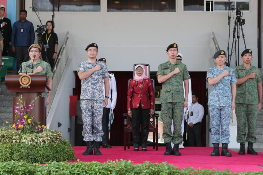 Chief of Defence Force Melvyn Ong (far left), with President Halimah Yacob in attendance, leading SAF personnel in reciting the SAF pledge to reaffirm their loyalty to the country and their commitment to the defence of Singapore on July 1, 2019.