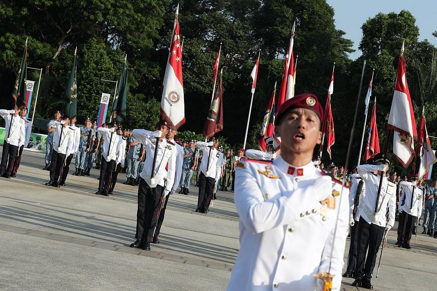 More than 3,000 SAF personnel reaffirming their loyalty to the country and their commitment to the defence of the country as the Singapore Armed Forces commemorated SAF Day at a parade officiated by President Halimah Yacob at the Safti Military Insti