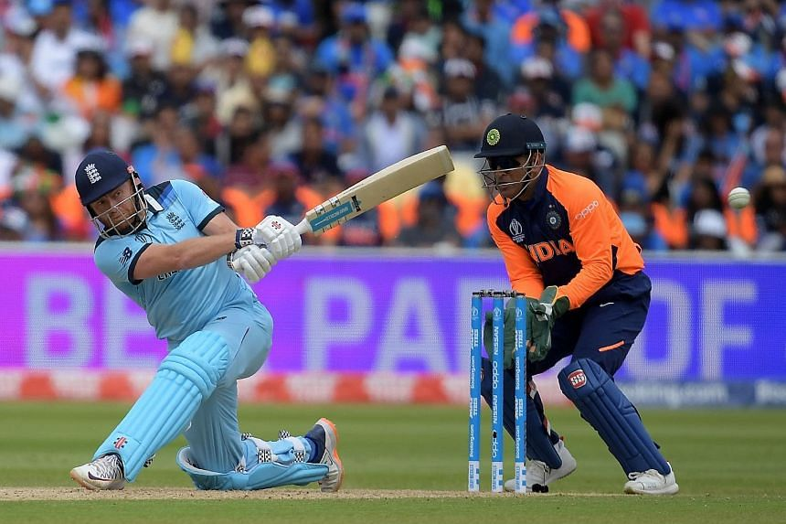 England's Jonny Bairstow, under the watchful eye of India wicketkeeper M.S. Dhoni, hitting the ball en route to a 111 from 109 balls during their Cricket World Cup round-robin match at Edgbaston in Birmingham on Sunday.
