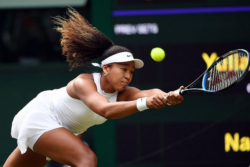 Japan's world No. 2 Naomi Osaka was stunned 7-6 (7-4), 6-2 by Yulia Putintseva in the first round of Wimbledon yesterday. It was her second loss to the Kazakh in a month. PHOTO: EPA-EFE