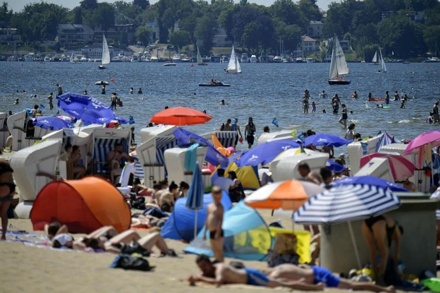 Beachgoers on a sunny day at the Wannsee lake as a heatwave in Europe continues, on June 30, 2019, in Berlin, Germany.