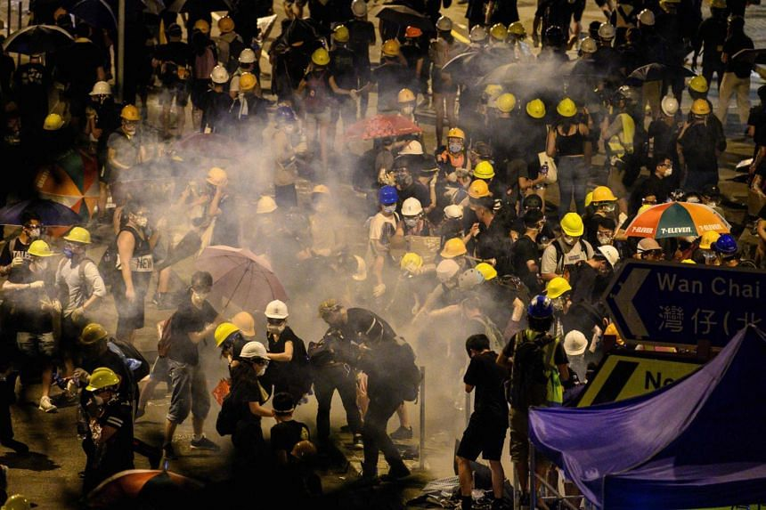Police fire tear gas at protesters near the Legislative Council building in Hong Kong early on July 2, 2019.