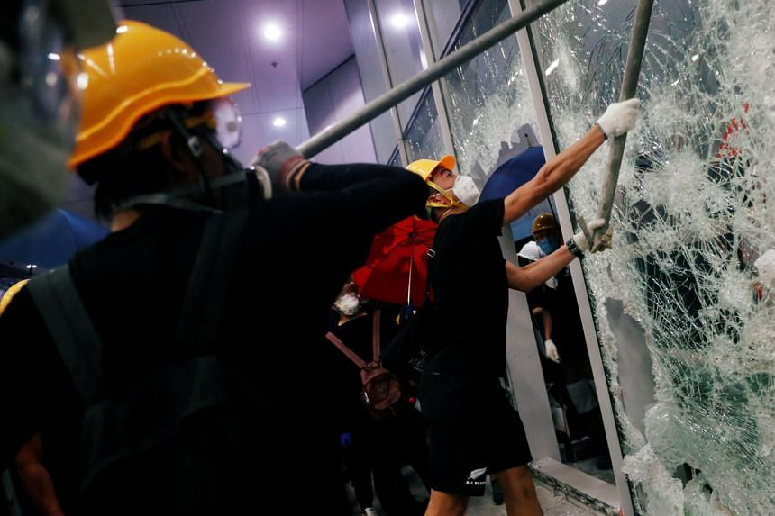 Protesters breaking into the Legislative Council building on July 1, 2019.