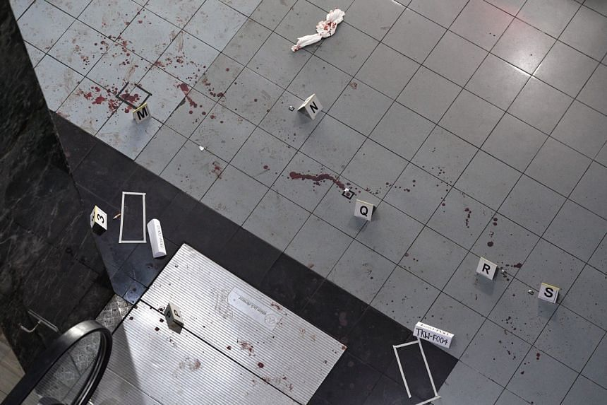 A pool of blood could be seen near the staircase leading to the building.