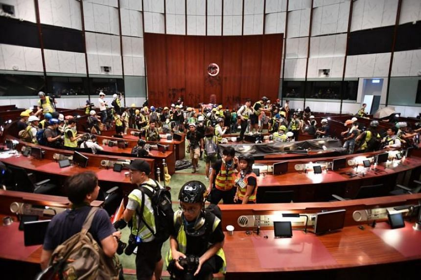 Protesters inside the legislative chamber after breaking into the Legislative Council Complex on July 1, 2019.