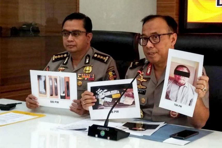 Photographs of leader Para Wijayanto and various seized items are shown at a press conference in Jakarta on July 1, 2019.