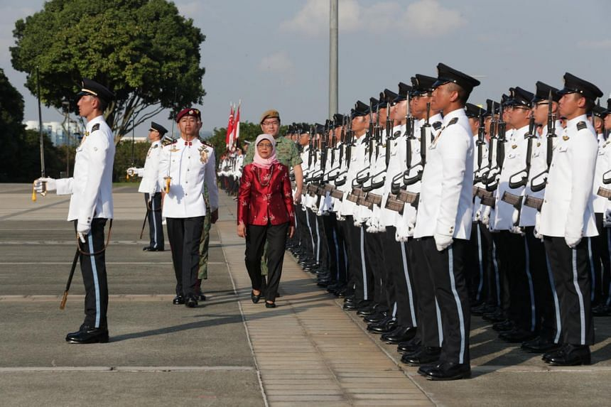 President Halimah Yacob inspecting the SAF Day Parade at Safti Military Institute in Jurong West, on July 1, 2019.