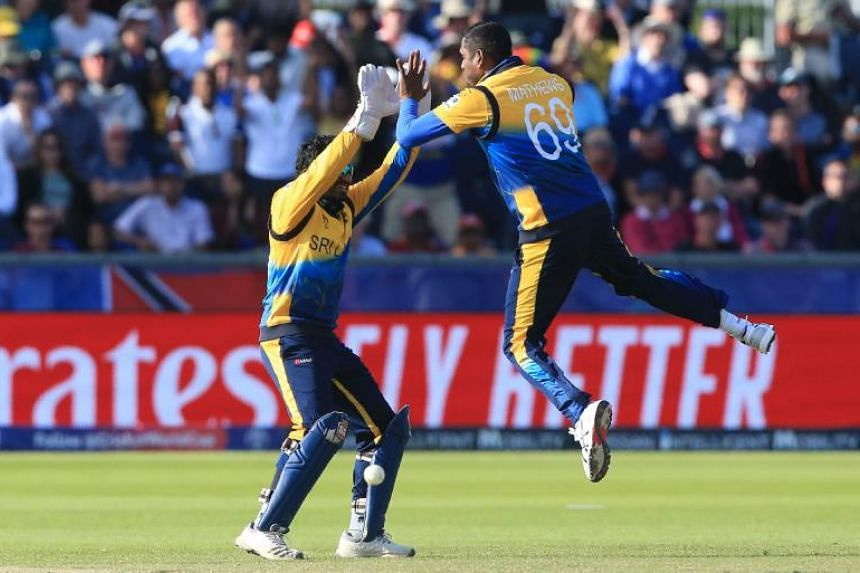 Sri Lanka's Lasith Malinga (right) celebrates with teammate Kusal Perera after their Cricket World Cup group stage match against West Indies at the Riverside Ground in Chester-le-Street, England, on July 1, 2019.