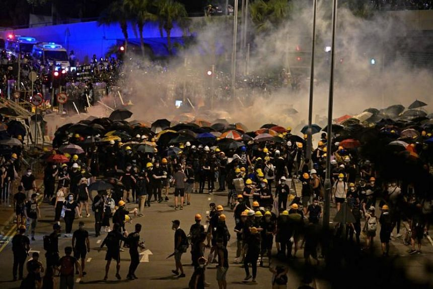 Police fire tear gas at protesters near Hong Kong's government headquarters on July 2, 2019.