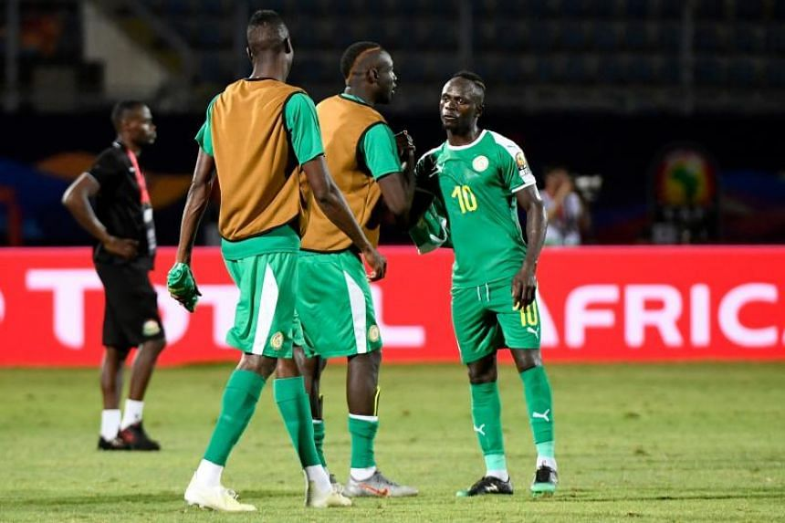 Senegal's forward Sadio Mane (right) celebrates after winning the Africa Cup of Nations Group C match against Kenya and Senegal at the 30 June Stadium in Cairo on July 1, 2019.