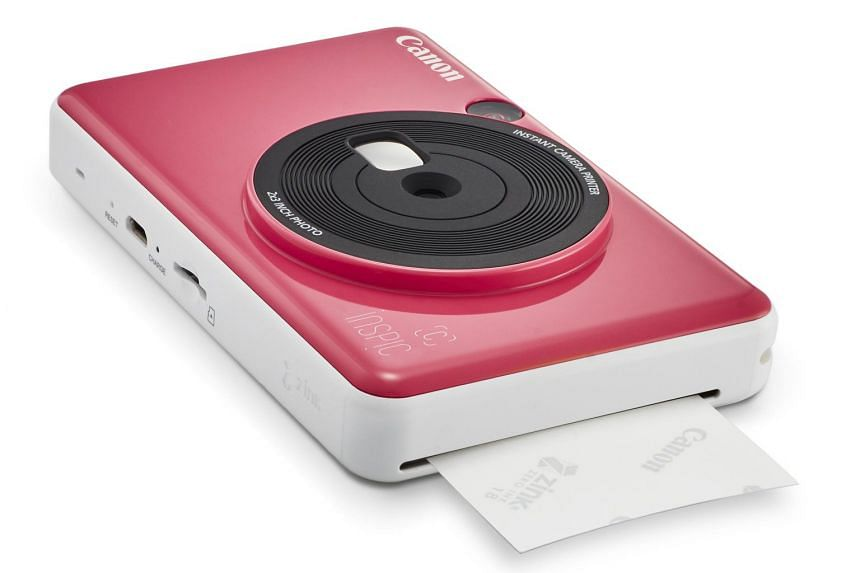 The Canon iNSPiC (S) has an 8-megapixel camera with a fixed wide-angle lens of 25.4mm.
