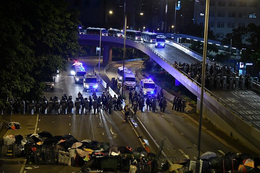 Police in riot gear on Harcourt Road after midnight on July 2, 2019.