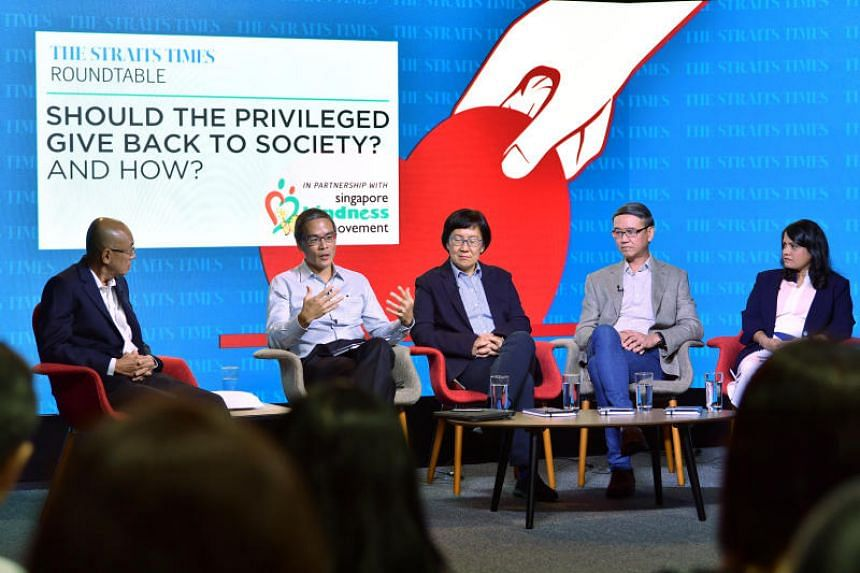 The Straits Times editor-at-large, Han Fook Kwang (left), chairs a panel discussion, in partnership with Singapore Kindness Movement, on the topic of giving back to society by the privileged.