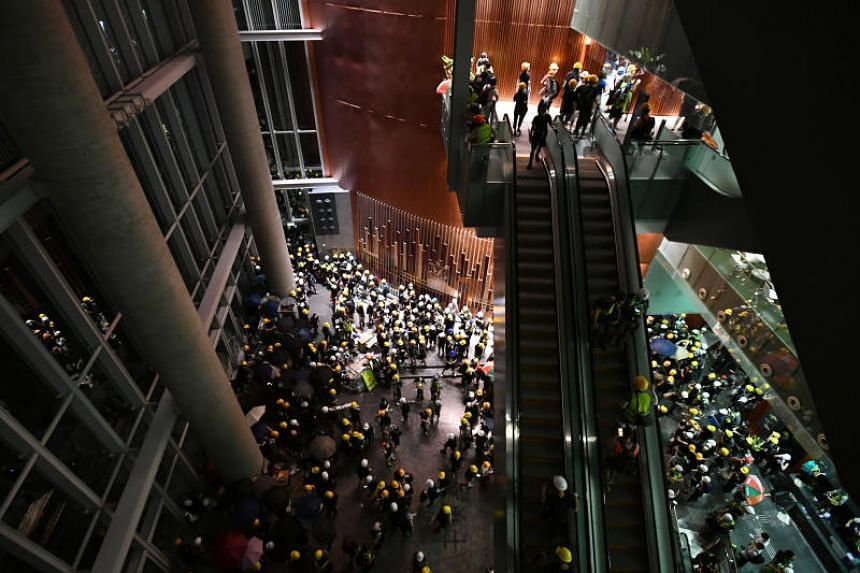Protesters enter the Legislative Council complex on July 1, 2019.