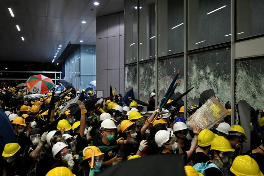Protesters bring supplies into the Legislative Council complex on July 1, 2019.