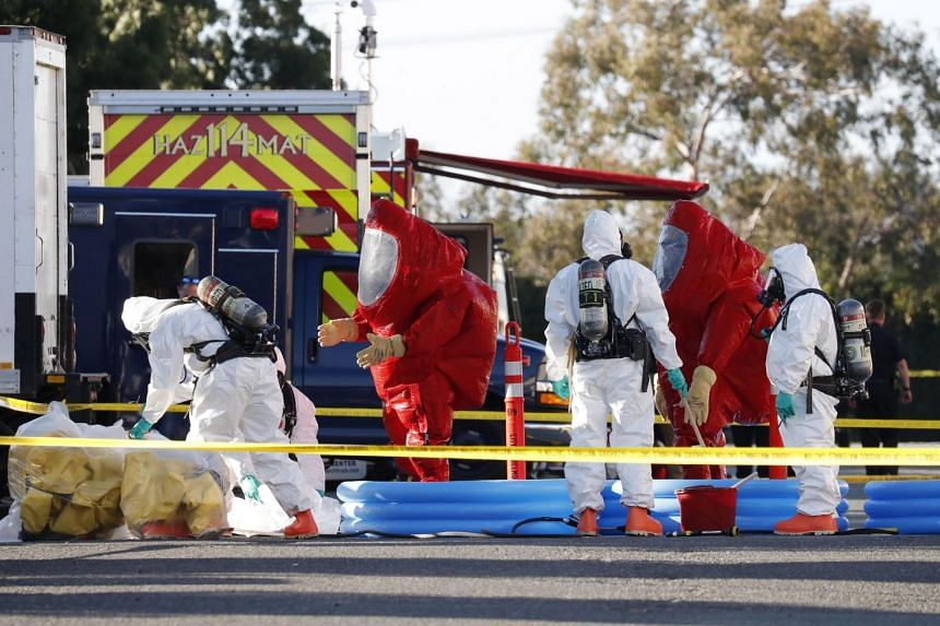 Response teams from Menlo Park Fire Department, the FBI and Hazmat get cleaned off after exiting a Facebook mail facility were they were testing for sarin poison.