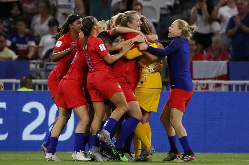 United States players celebrate winning the match against England.