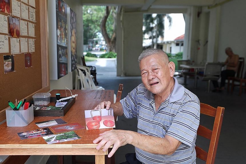 Retiree Jason Ong, 72, with a photo of a red traditional wedding basket used by his grandmother, mother and wife.
