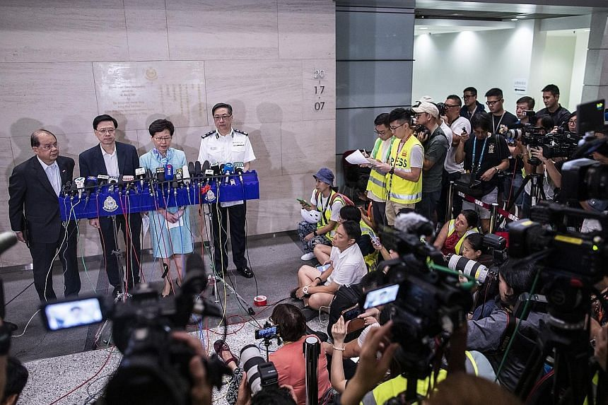 Hong Kong Chief Executive Carrie Lam speaking to the media early yesterday morning after police cleared out protesters from the Legislative Council building. With her were (from left) Chief Secretary Matthew Cheung, Secretary for Security John Lee an