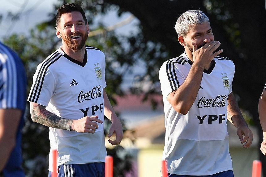 Argentina captain Lionel Messi and fellow forward Sergio Aguero share a joke ahead of their Copa America semi-final clash with Brazil. Messi has yet to shine in the competition, with just one goal in four matches. PHOTO: AGENCE FRANCE-PRESSE