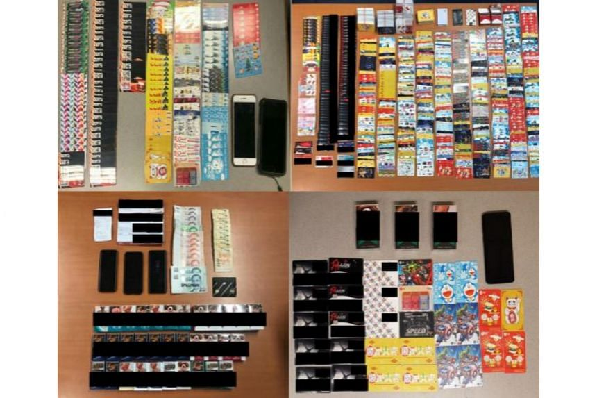 The police seized several items including $9,000, several mobile phones, stacks of ez-link cards, cash cards and bank cards from the suspects.