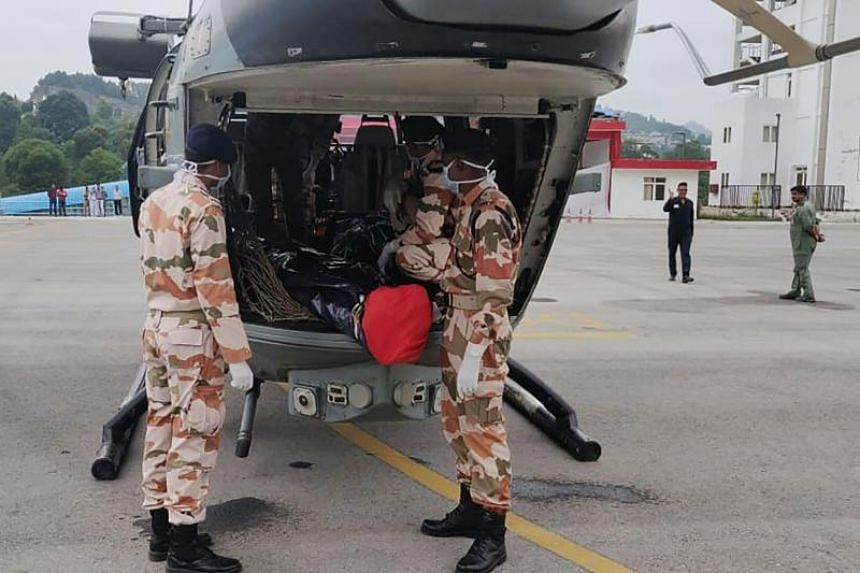 Indo-Tibetan Border Police personnel prepare to remove the bodies of mountaineers retrieved from Nanda Devi in the Himalayas, in Pithoragarh, India, on July 3, 2019.
