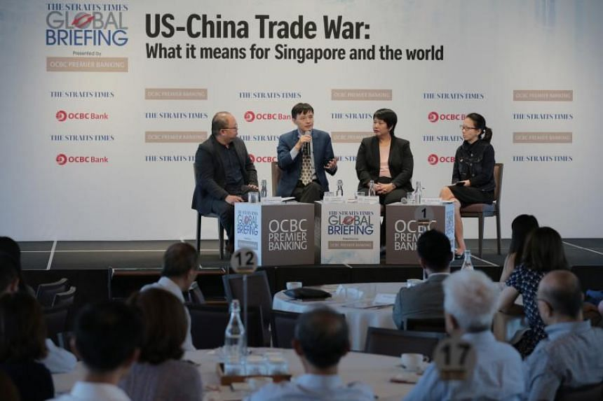(From left) ST foreign editor Jeremy Au Yong, Associate Professor Li Mingjiang, OCBC economist Selena Ling and ST tech editor Irene Tham at The Straits Times Global Briefing on the US-China trade war on July 3, 2019.