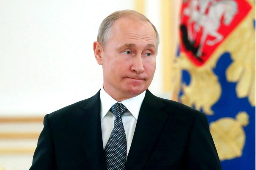 Russian President Vladimir Putin has signed legislation suspending a 1987 nuclear missile treaty.