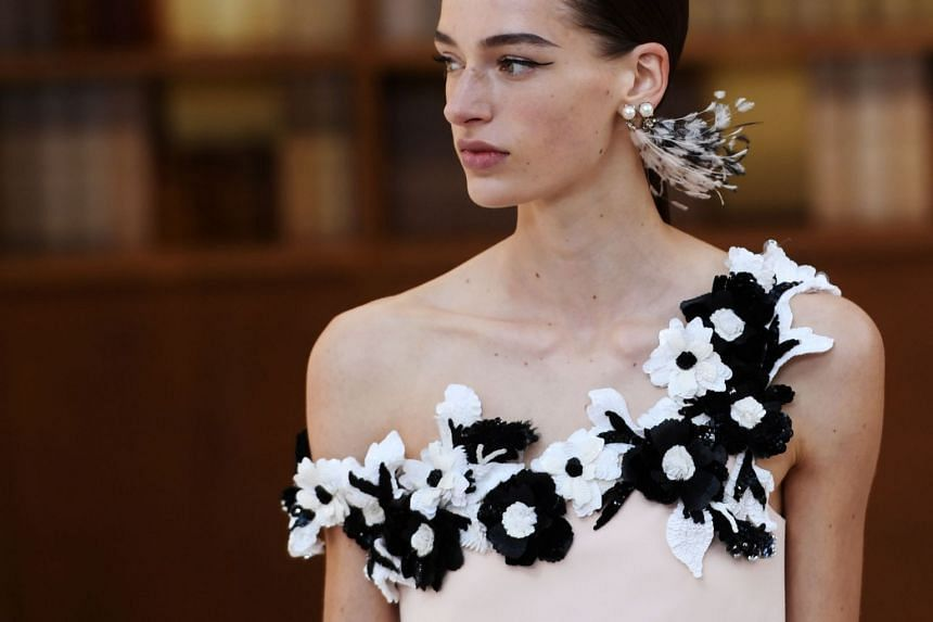 A model presents a creation by Chanel.
