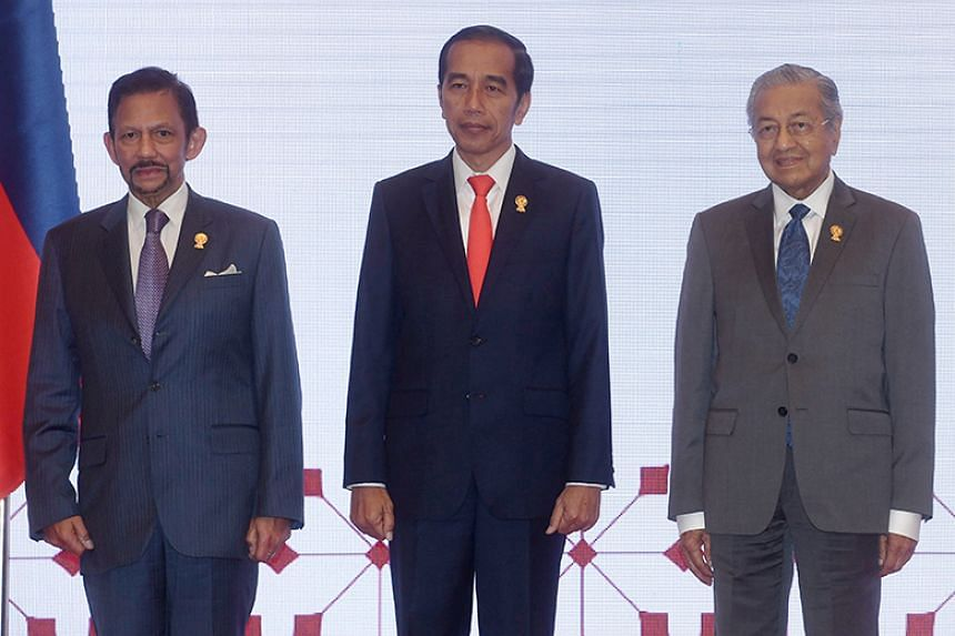 (From left) Brunei's Sultan Hassanal Bolkiah, Indonesian President Joko Widodo and Malaysian Prime Minister Mahathir Mohamad will be attending Singapore's National Day Parade at the Padang next month.