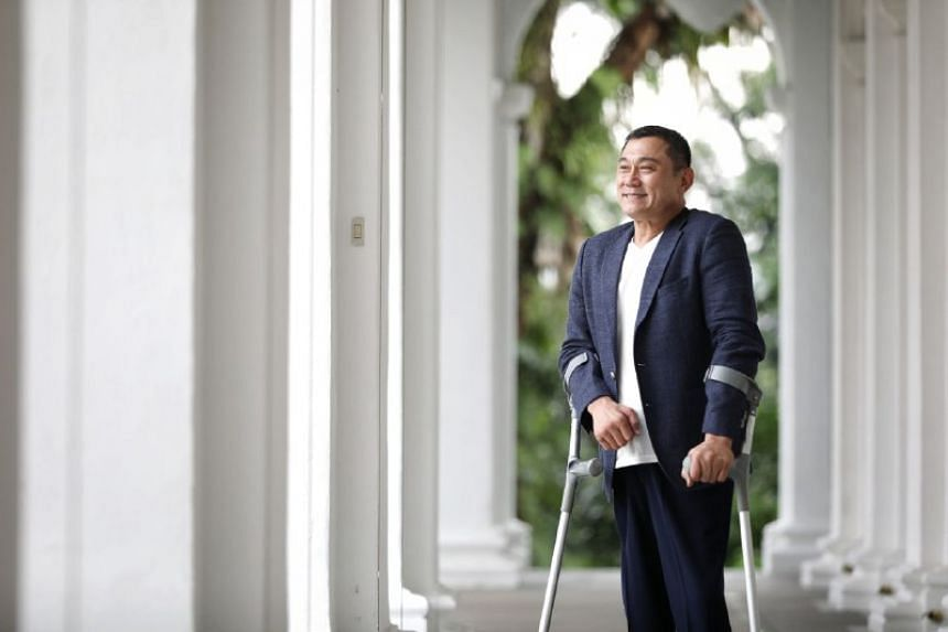 Mr Michael Ngu, the president and chief executive of Architects 61, contracted polio when he was five and became paralysed in both legs. His disability did not stop his dream of becoming an architect.