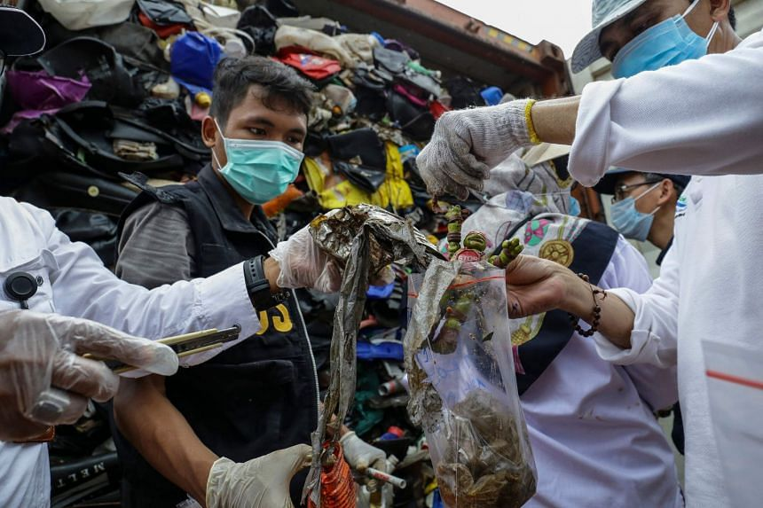 Indonesian officials check one of the 49 containers loaded with a combination of garbage, plastic waste and hazardous materials in violation of import rules, on Batam island.