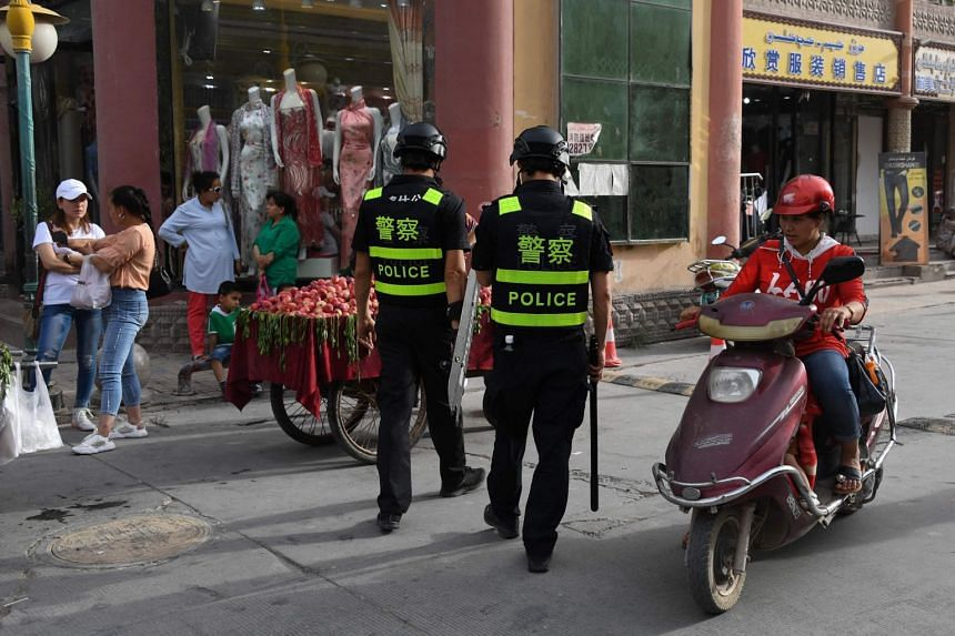 Police officers patrolling in Kashgar in China's western Xinjiang region, on June 4, 2019.