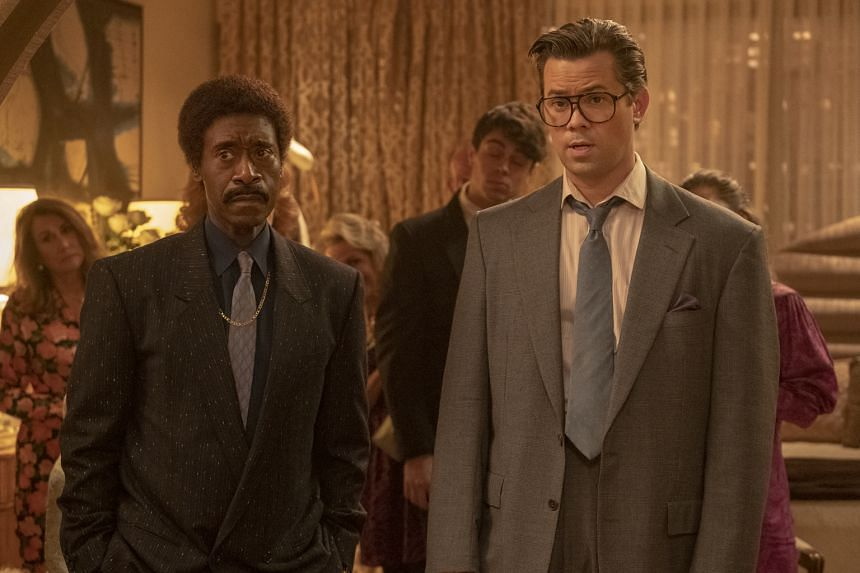 Don Cheadle (left) and Andrew Rannells play debauched stockbrokers from the 1980s in Black Monday.
