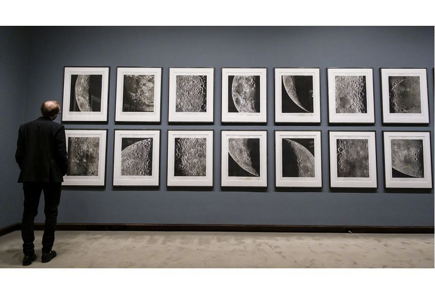 Images from Photographic Atlas Of The Moon on display at Apollo's Muse: The Moon In The Age Of Photography, an exhibition at the Metropolitan Museum of Art in New York.