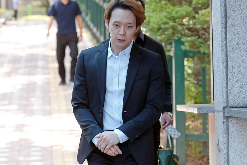 Park Yoo-chun leaving a detention centre in Suwon, South Korea, yesterday, after he was sentenced to two years of probation and fined about $1,630 over drug use.