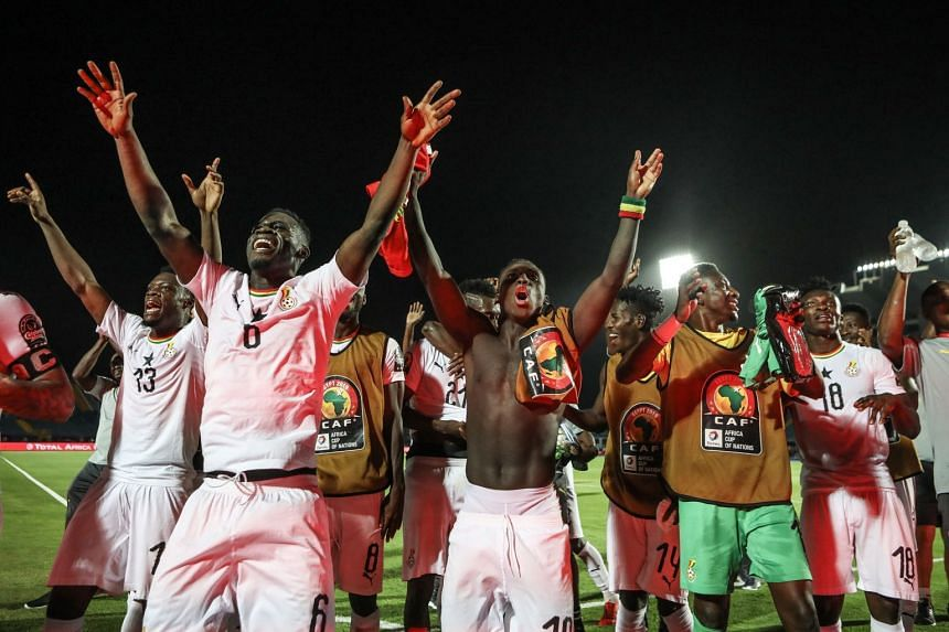 Ghana players celebrate after the final whistle.