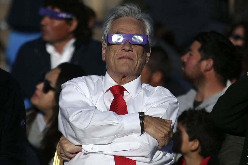 Chile President Sebastian Pinera watches the total solar eclipse.