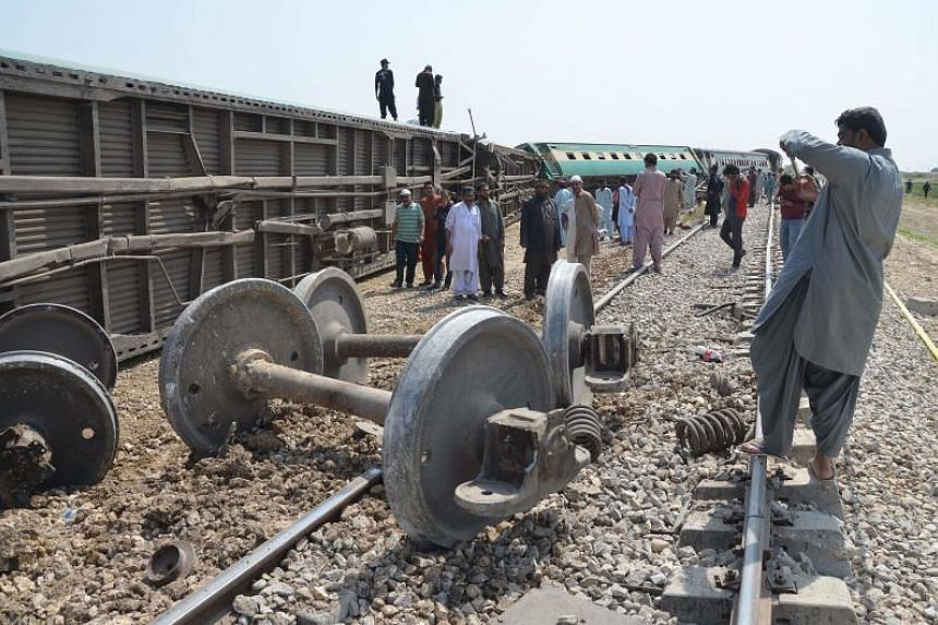 Pakistani passengers and villagers gather after a remote-controlled bomb exploded on a railway line in Nasirabad in the province of Balochistan, on March 17, 2019.