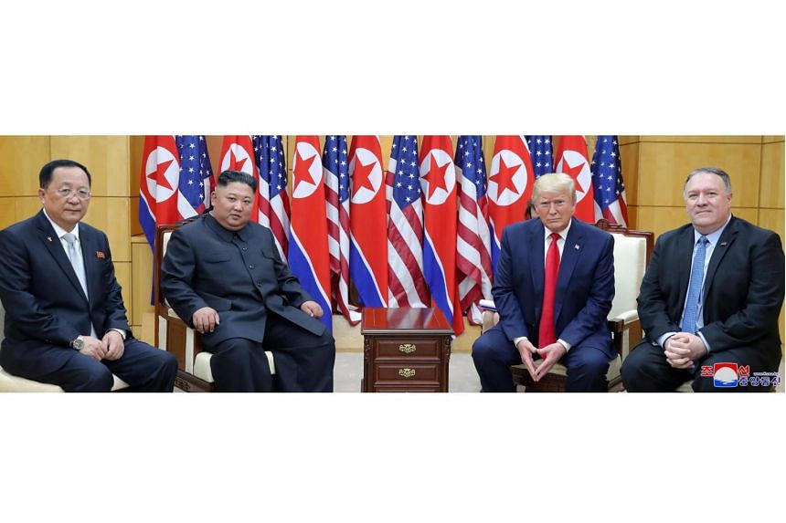 (From left) North Korean Foreign Minister Ri Yong Ho and its leader Kim Jong Un, and US President Donald Trump and Secretary of State Mike Pompeo during a meeting at the Demilitarised Zone separating the two Koreas on June 30, 2019.