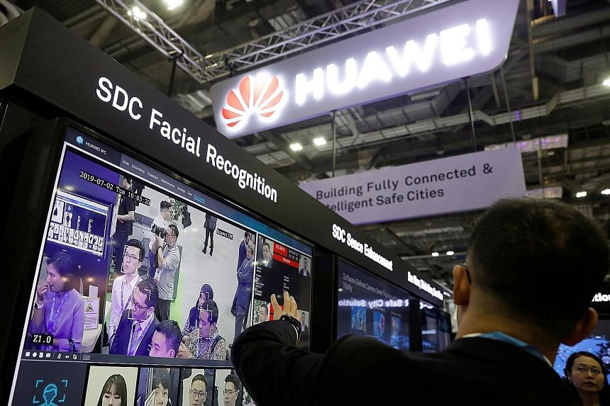 Huawei's booth at a fair in Singapore earlier this week. US President Donald Trump has sowed confusion with a vow to ease a ban on sales to the firm.