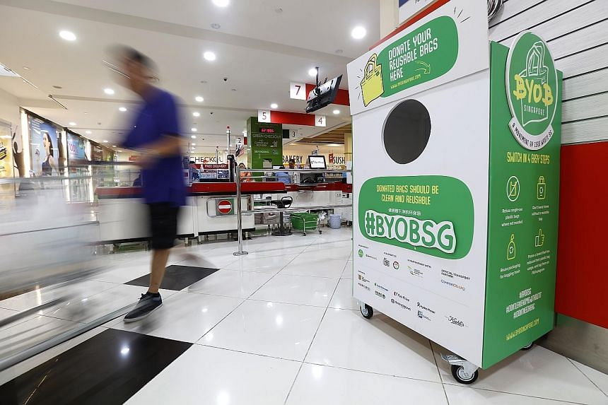 A donation bin for reusable bags at FairPrice Xtra in Kallang Wave Mall. Bins for the public to donate unused reusable bags have been placed at eight supermarket outlets - two each from FairPrice, Cold Storage, Sheng Siong and Prime Supermarket - and
