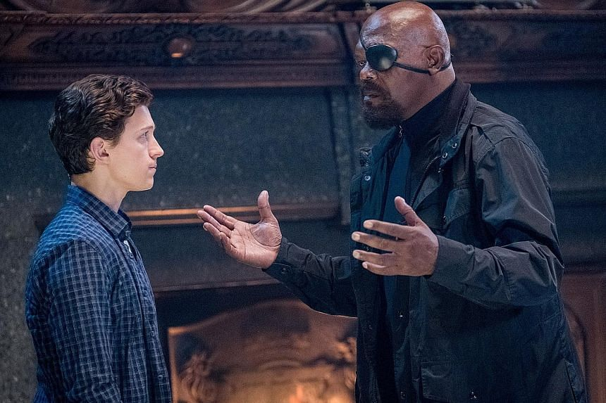 Tom Holland plays the web-slinging superhero, while Samuel L. Jackson (both above) is Nick Fury.