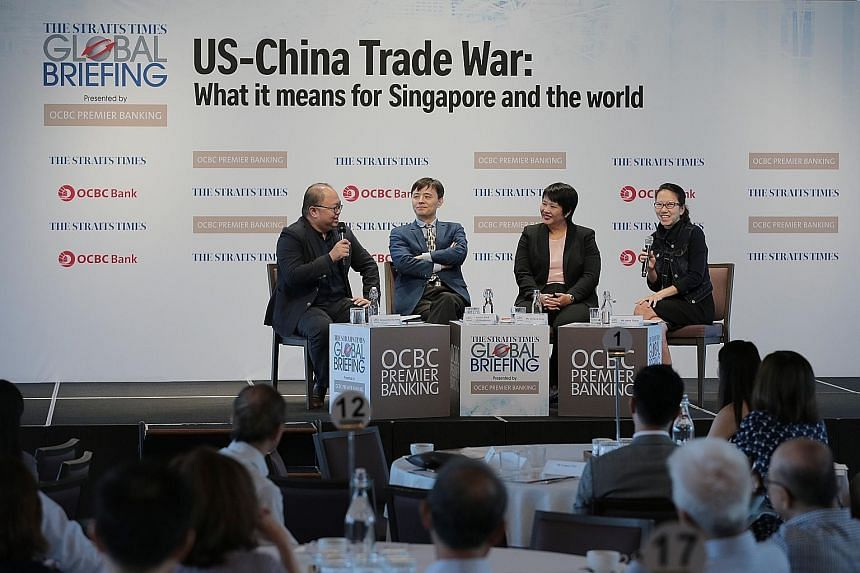 (From far left) ST foreign editor Jeremy Au Yong, Associate Professor Li Mingjiang of the S. Rajaratnam School of International Studies, OCBC economist Selena Ling and ST tech editor Irene Tham discussing the impact of the US-China trade war on the w