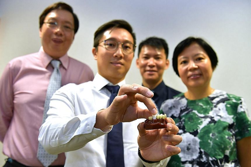 The 3D-printed dental plug aids bone growth in the jaw, reducing chances of bone shrinkage after an extraction. (From left) Chief executive of Singapore Clinical Research Institute Teoh Yee Leong, Osteopore chief technology officer Lim Jing, co-inves