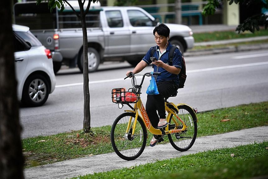 A Moov shared-bike user in Jurong West yesterday. The firm has a licence from LTA to operate up to 1,000 bicycles here.